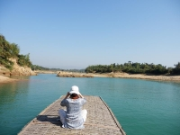 A visitor enjoying a quiet moment on Sari River