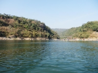 Catching a glimpse of the mountains of the Indian border from the river in Jafflong