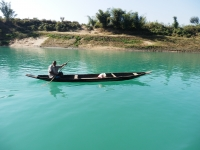 Lonely Boatman looking for passengers on Sari river